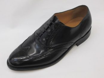 The Albert model shoe is a Classic styled oxford tie laced Brogue in black hi-shine leather, with all leather-lining & foot-bed. It has a 7mm Goodyear welted leather sole. From Barkers 'Professional Collection'. The Albert is shown here in oblique view.