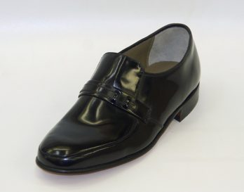 The Campbell model dress shoe by Barker of the UK is an Apron Vamp slip on style, with uppers made of hi-shine leather, and lined with leather quarters with a leather sock. The soles are all leather cemented, with leather heels that have rubber top pieces. The Campbell is shown here in oblique view.