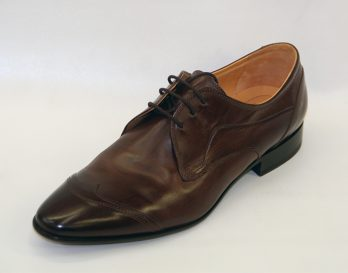 The Galizio Torresi 312626 toe cap 3 tie derby lace up shoe has a Mid Brown or Black Coloured Leather Upper, and a Stitched-on Leather Sole with Rubber Protector Inserted, part Rubber Top Pieces on Heel. The brown model is shown here in oblique view.