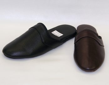 The Durham model slipper by Givani has a deerskin upper, with wool lining and leather at the heel, with a stitched suede sole, at Mark Kendall Shoes, shown here in oblique view.. The Durham slipper is shown here as a pair.