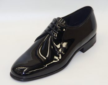 The Lloyd Phillip is a Plain 3-Tie Lace-Up Derby Shoe, and has a Patent Black Leather Upper, and Cemented Leather Sole with Rubber Top Pieces on Heels. The Phillip shoe is shown here in oblique view.