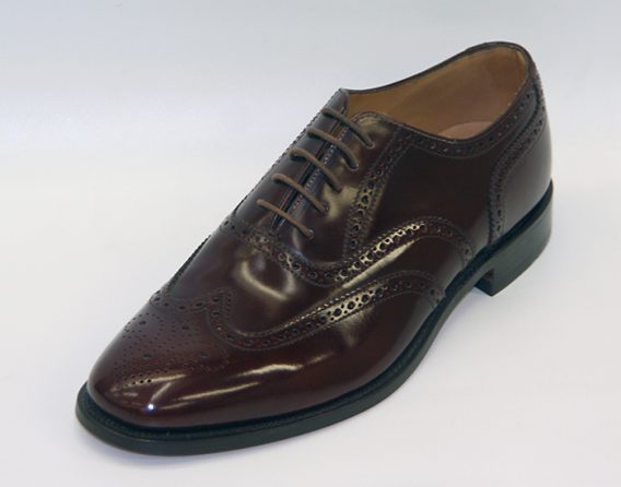 202T model is a leather oxford brogue shoe by Loake seen here in oblique view. At Mark Kendall Shoes Wellington.