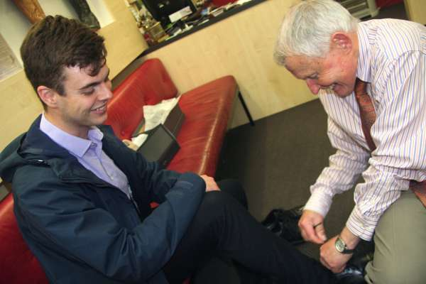 Customer shoe fitting personal service at Mark Kendall Shoes in Wellington city, New Zealand.