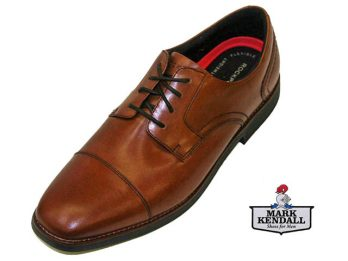 The Slayter by Rockport is a toe cap derby 4-tie lace up shoe. the Slayter has a full grain leather upper, and is wide fitting. The lining is textile, and has a removable foot-bed for added comfort. This model is a Great Business Shoe, Comfortable All Day Wear in a Traditional yet Modern Design. The Slayter is shown here in oblique view.